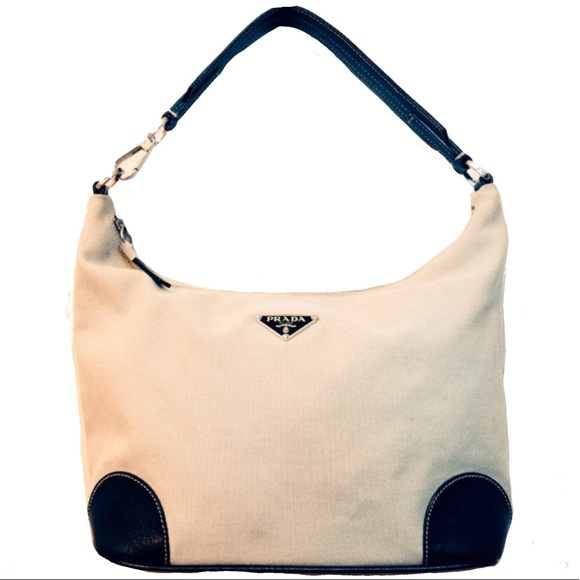 f68e1652f72 Vintage Prada Canvas Leather Hobo Bag. M 5a4098e285e605ab2a02508c